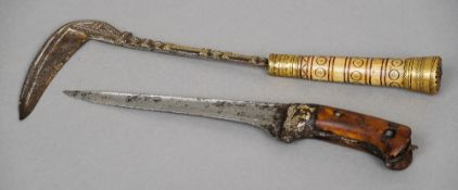 An early Indian dagger  Decorated with gold and silver pique work; together with an Afghan axe