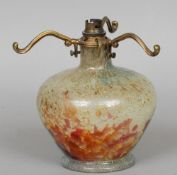 A Monart glass lamp base Decorated in mottled green, blue, red and copper tones, the underside