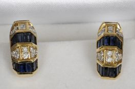 A pair of unmarked gold, diamond and sapphire set earrings Each of arched form with bands of