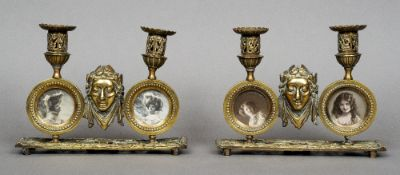 A pair of 19th century gilt metal twin candlesticks Each incorporating twin photograph frames