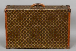 A Louis Vuitton suitcase The interior with label numbered 846650, the exterior typically decorated.