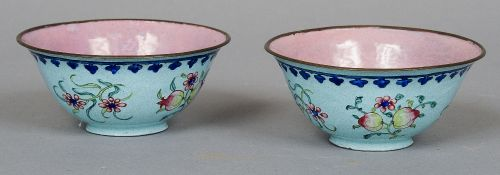 A pair of Cantonese enamel rice bowls The exteriors decorated in the round with fruiting blossoms