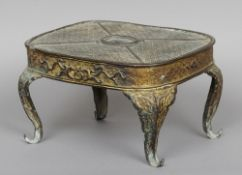 A Ming gilt bronze stand With ornate scroll cast decoration and scrolling cabriole legs.  31 cm