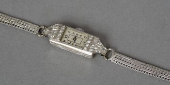 An Art Deco diamond set platinum cocktail watch
