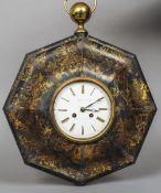 A 19th century tole ware wall clock Of domed octagonal form with gilt floral scrollwork