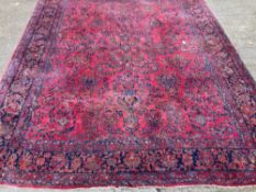 An early 20th century Persian wool carpet