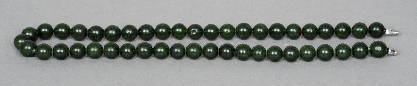 A Chinse carved jade type bead necklace