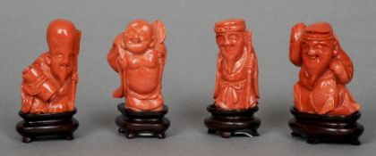 Four carved coral figures Variously worked on wooden stands.  The tallest 6 cm high.  (4) CONDITION