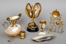 A collection of various shell mounted ormolu and white metal mounted ornaments Together with an