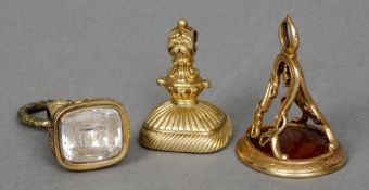 Three Regency gold desk seals The matrices carved with various crests and coats-of-arms.  The