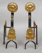 A pair of late 19th century brass and wrought iron andirons Each headed with pierced brass