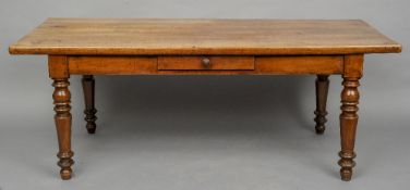 A 19th century French cherrywood farmhouse table The thick top above a plain frieze with a single