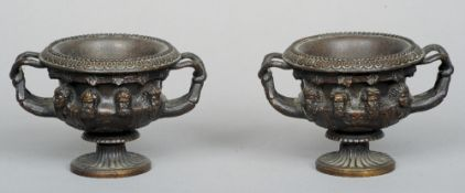 A pair of mid 19th century Continental patinated bronze albani vases, after the antique marble