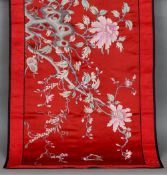 A Chinese silk work panel Worked with a pierced rock issuing floral sprays incorporating four