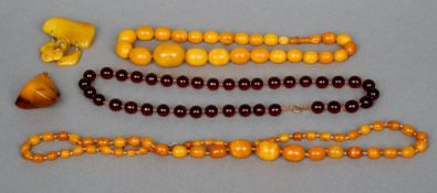 Two butterscotch amber necklaces, a butterscotch amber pendant and a butterscotch amber brooch