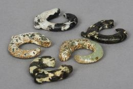Five Chinese jade pig dragons Each of typical curved form.  Each approximately 5 cm wide.  (5)