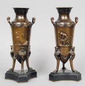 A pair of 19th century French bronze cassolets Each decorated in relief with classical figures,