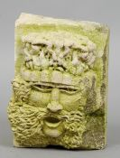 A carved stone head Depicting a bacchic figure.  30 cm high. CONDITION REPORTS: Some chips and
