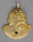 A 9 ct gold diamond set pendant Formed as the bust of a young lady with ringlets in her hair.  3.