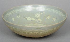 An Korean 13th century Koryo Dynasty celadon glazed bowl With inlaid white slip floral