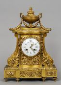 A French 19th century ormolu mantel clock by Vassy, Paris The white enamelled dial with Roman
