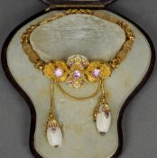 A 19th century topaz set and porcelain mounted yellow metal bracelet Formed as stylised flowerhead