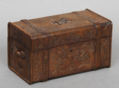 A 19th century Continental carved wooden box Formed as a travelling trunk with floral decoration.