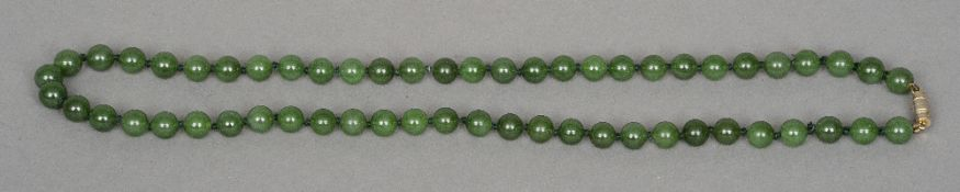 A spinach jade bead necklace