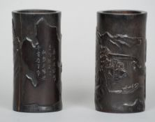 A pair of Chinese carved bamboo brush pots Each worked with pavilions in a mountainous landscape