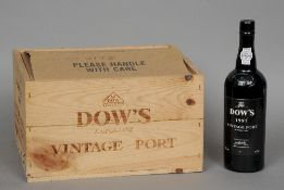 Four bottles of Dow's Vintage Port 1997 In old wooden half case.  (4) CONDITION REPORTS: Generally