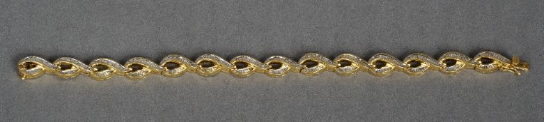 An 18 ct gold, diamond set bracelet