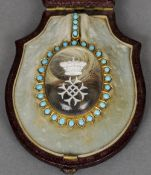 A 19th century turquoise set and sulphide glass yellow metal memorial pendant Of oval form enclosing