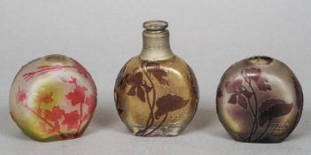 Three early 20th century Galle cameo glass scent bottles Each typically decorated with floral