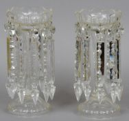 A pair of Victorian clear glass table lustres Of typical fluted form with facet cut drops.  Each