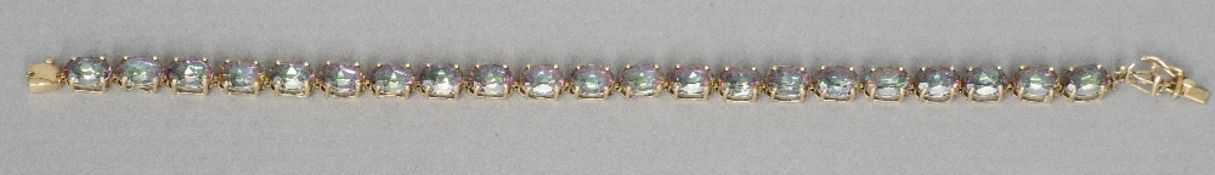 A 9 ct gold framed stone set bracelet Each link of faceted oval form.  18.5 cm long. CONDITION