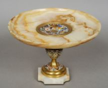 A 19th century Continental enamel decorated alabaster tazza The dished top centred with an enamel