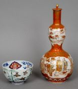 A 19th century Japanese Kutani porcelain vase and cover Double gourd and decorated with figural
