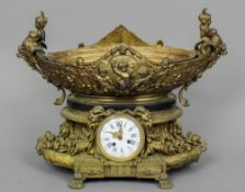 A 19th century gilt bronze centre piece The oval bowl with cherub decorations above the florally