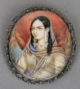 MUGHAL SCHOOL (19th century) Portrait miniature of Maharani in Traditional Costume In pierced