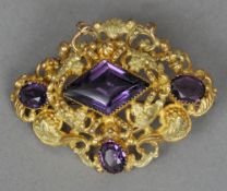 A 19th century coloured paste set Pinchbeck brooch