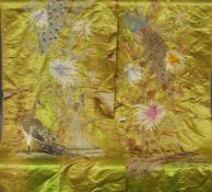 A pair of Chinese embroidered silk panels Decorated with pheasants amongst foliage on a green