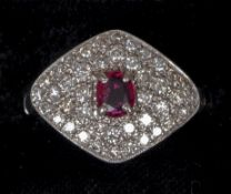 An Art Deco platinum, diamond and ruby set ring
