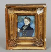 An early 19th century portrait miniature on ivory Depicting a young gentleman seated in a blue