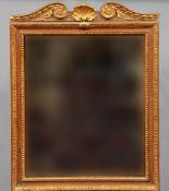 A 19th century gilt decorated mirror The silvered plate within a moulded frame with scrolling