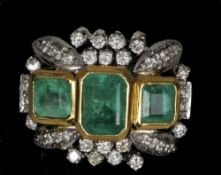 An 18 ct gold emerald and diamond ring