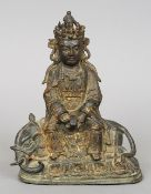 An early gilt heightened bronze model of Buddha Modelled seated astride a recumbent elephant with