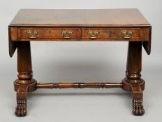 A 19th century mahogany sofa table The twin flap top above two frieze drawers, supported on
