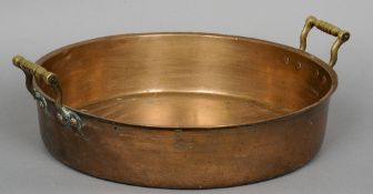 A late 18th/early 19th century bronze skillet pan Of typical form with twin brass handles.  46 cm