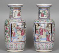 A pair of late 19th century Canton porcelain vases Each decorated with figural and scenic
