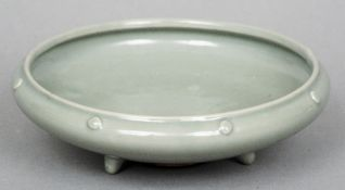 A Chinese Ming/Song Dynasty celadon glazed shallow bowl The rim with pronounced studs, standing on